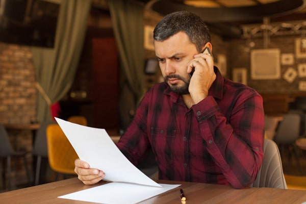 Man Reading IRS Letter