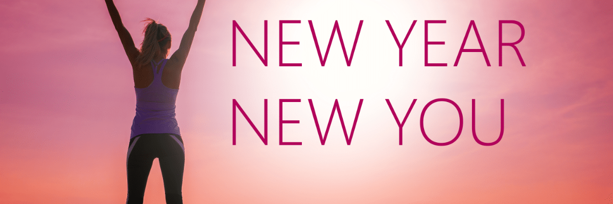 New Year New You Sign with woman raising her arms in triumph
